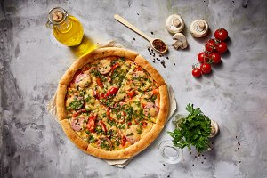 Tasty pizza, parsley, tomatoes