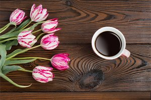 Cup of coffee and tulips.