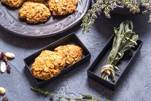 Vegan oat cookies in black carton bo