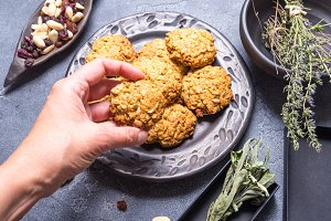 Woman hand taking oat cookies
