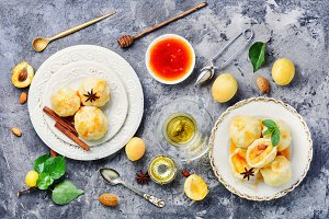 Dumplings with apricot and syrup