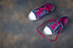 Blue Sports shoes with pink shoelace