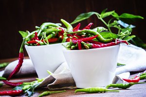 Red and green chili peppers in white