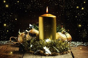 Golden burning candle, tinsel, Chris