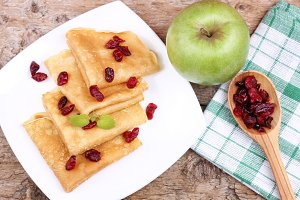 Berries, apple and pancakes