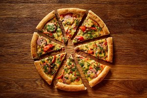 Freshly baked pizza divided into