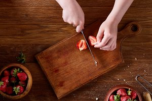 Knife in girl's hand cutting a fresh