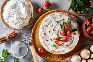Strawberry tart covered with whipped