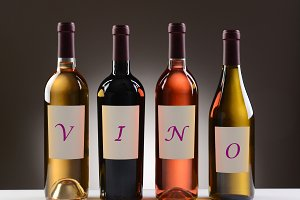 Wine Bottles With Labels Spelling Ou