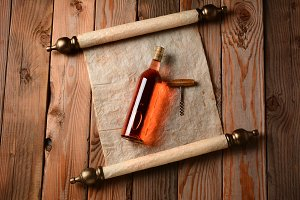 Wine Bottle and Corkscrew on Scroll