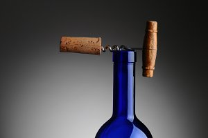 Corkscrew and Cork on Top of Wine Bo