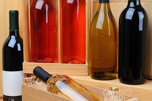 Assortment of wine bottles on crates