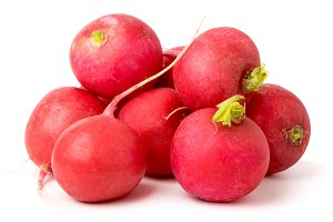 Bunch of ripe radishes on a white. i