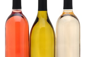 Three Wine Bottles over a White Back