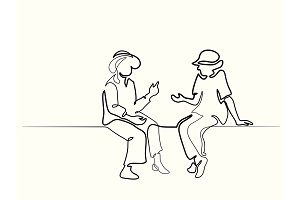Two sitting old women talking