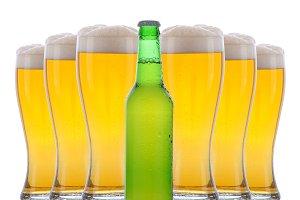 Beer Bottle in Front of Full Glasses