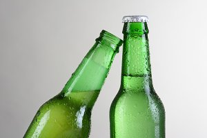 Closeup Green Beer Bottles One Tilte