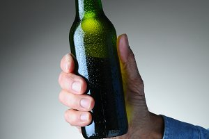 Hand Holding Beer Bottle
