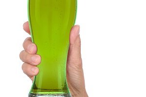 Hand Holding Glass of Foamy Green Be