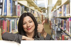 Hispanic Woman with Thumbs Up On Whi