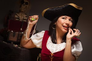 Dramatic Female Pirate Biting A Coin