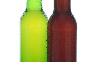 Two Beer Bottles in Ice with Condens