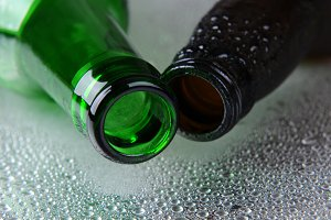 Closeup of two beer bottles on Wet S