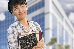 Mixed Race Female Student Holding Bo