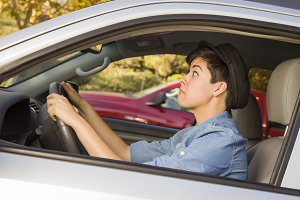 Stressed Mixed Race Woman Driving in