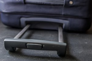 close up baggage case handle grip on