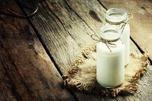Fresh cow milk or cream in glass bot