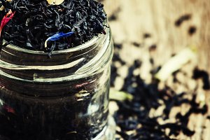 Dry black tea in a glass jar, vintag
