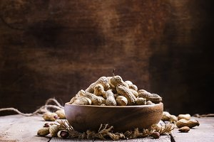 Peanuts in shell in a wooden bowl, s