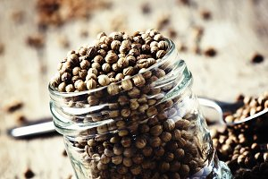 Coriander seed in a glass jar, vinta