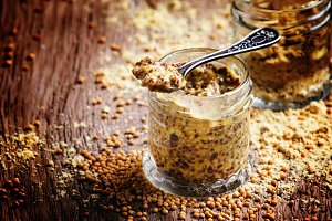 Mustard sauce with grains, old woode