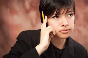 Multiethnic Girl Ponders While Holdi