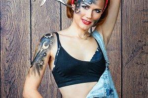 Girl mechanic with face art posing