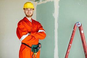 Joyful foreman in orange work