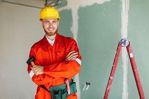 Smiling builder in orange work