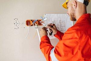 Close up builder in orange work