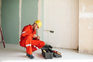 Foreman in orange work clothes and