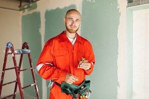Smiling foreman in orange work