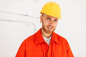 Portrait of young smiling builder in