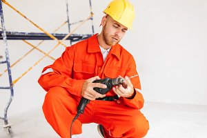 Builder in orange work clothes and