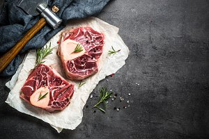 Raw beef steak osso bucco on black