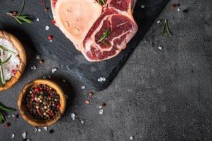 Raw beef steak osso bucco on black