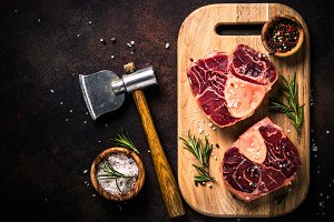 Raw beef steak osso bucco on cutting
