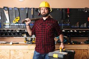 Foreman in hardhat holding hammer on