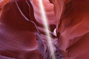 A thin ray of sunlight illuminates t
