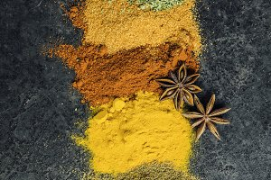 Spices and herbs on a dark backgroun